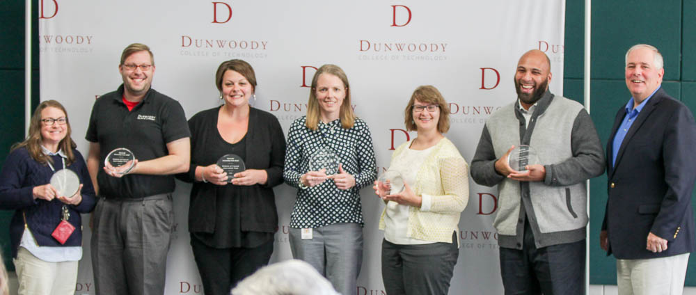 Pictured from left to right: Molly Malone Docken, Zac Mans, Charla Hudlow, Kelli Sattler, Maggie Whitman, Jonathon Moore and College President Rich Wagner