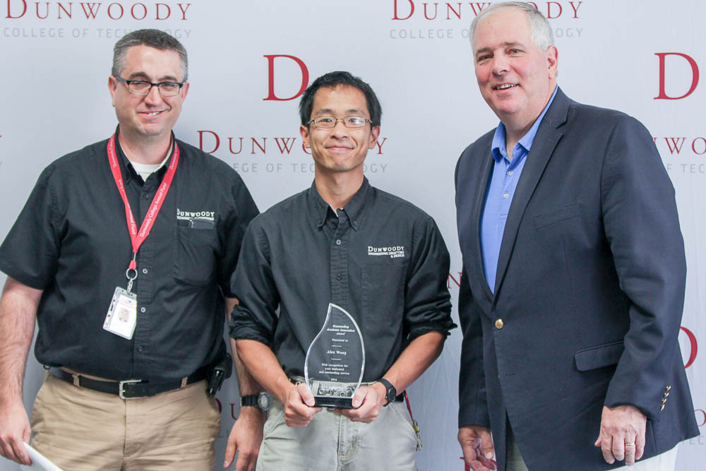 Pictured from left to right: Dean of Robotics & Manufacturing E.J. Daigle, Instructor Alex Wong and College President Rich Wagner