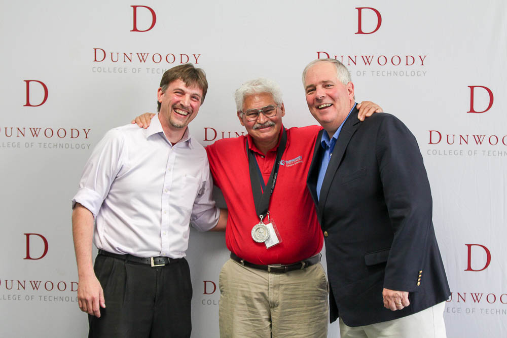 Pictured from left to right: Computer Technology Program Manager Rob Bentz, Principal Instructor Rich Arboleda and College President Rich Wagner