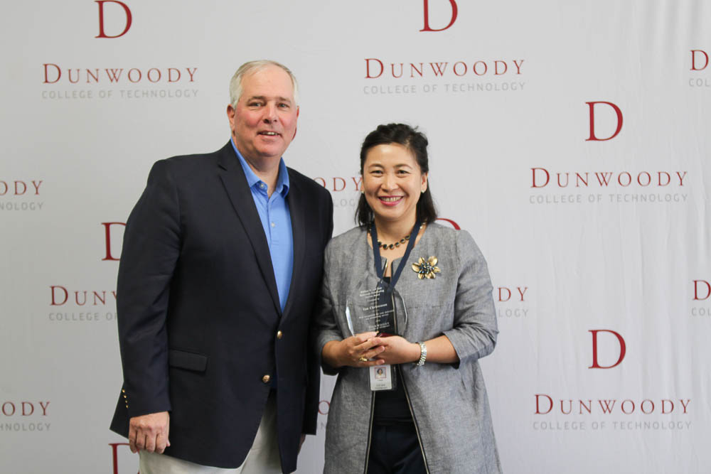 Pictured from left to right: College President Rich Wagner and Registrar Yun Christenson