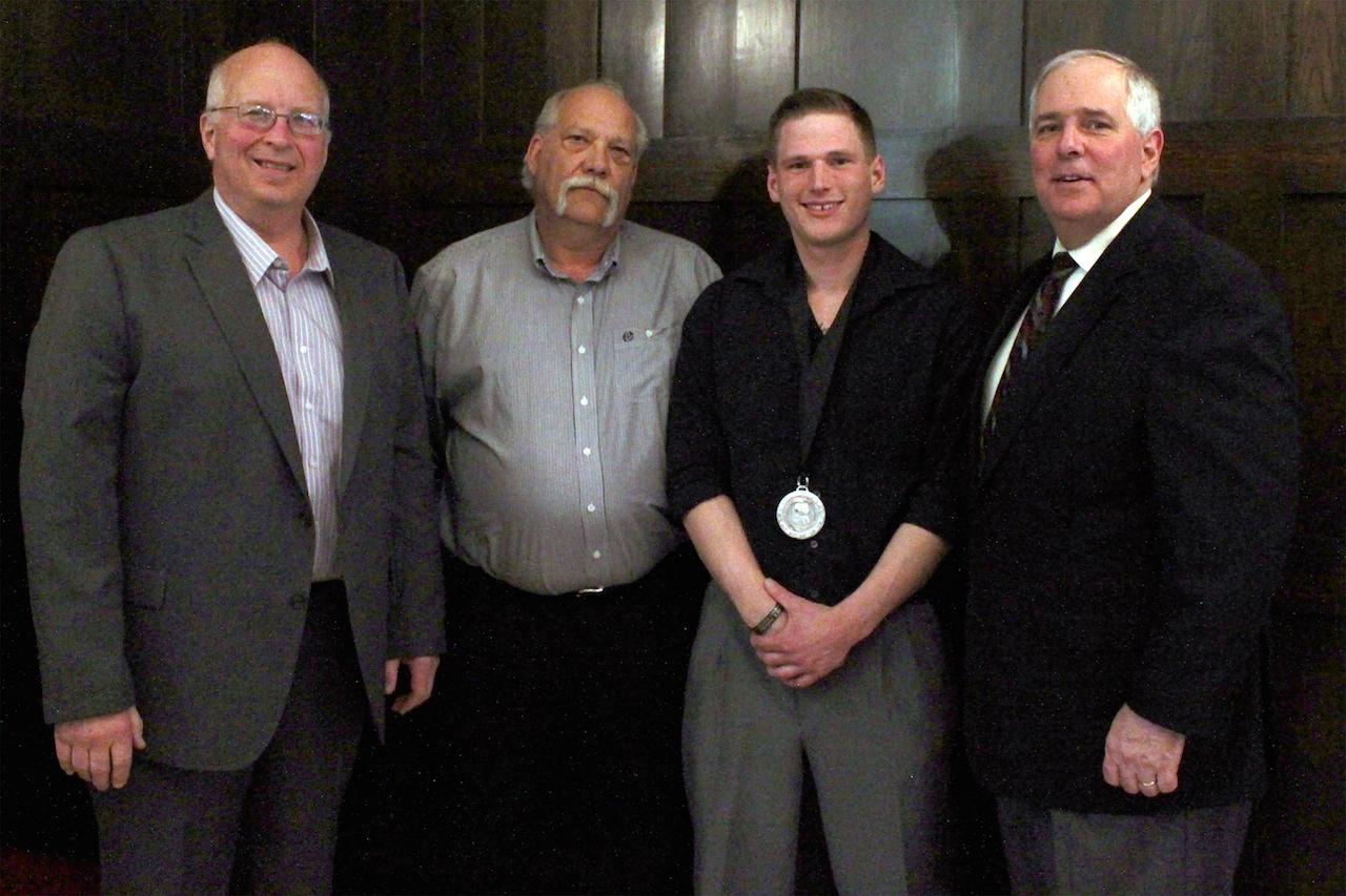 Pictured from left to right: Dean of Automotive Programs Steve Reinarts, Automotive senior instructor Scott Zubrod, Michael Jindra and College President Rich Wagner