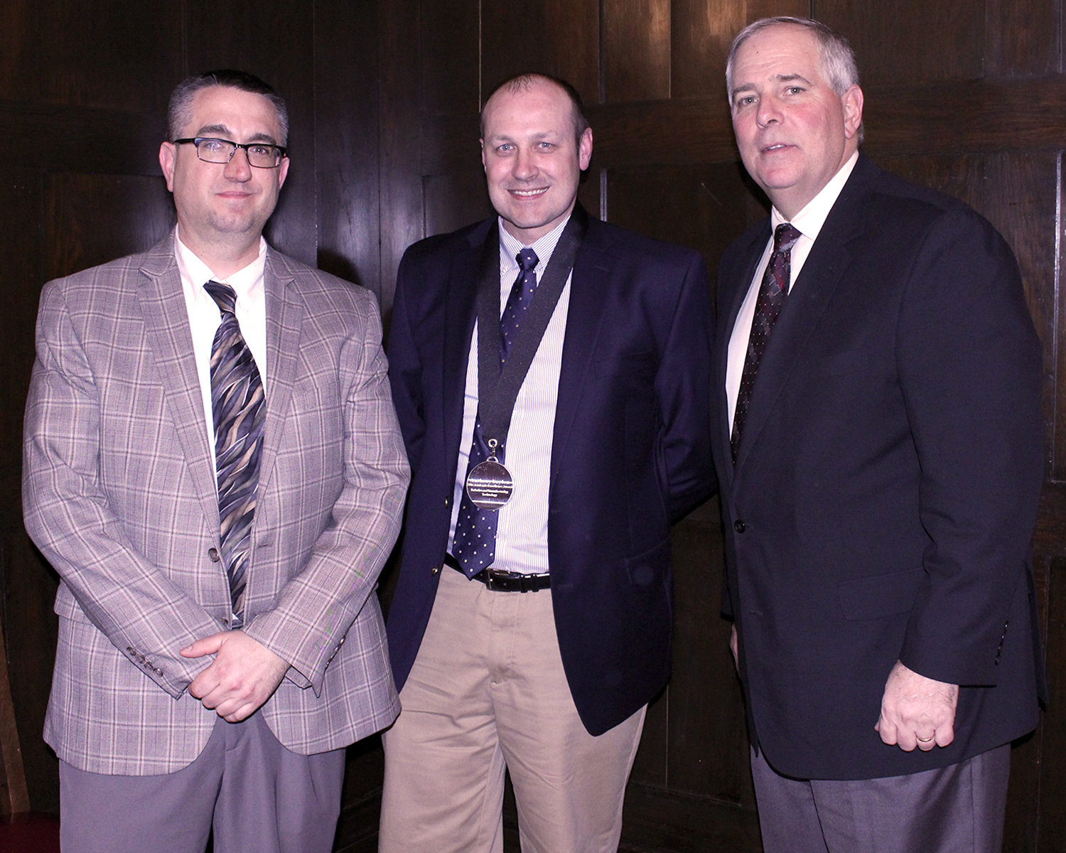 Pictured from left to right: Dean of Robotics & Manufacturing E.J. Daigle, Anthony Laylon and College President Rich Wagner