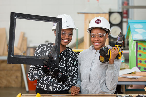 Photo of girls holding power tools